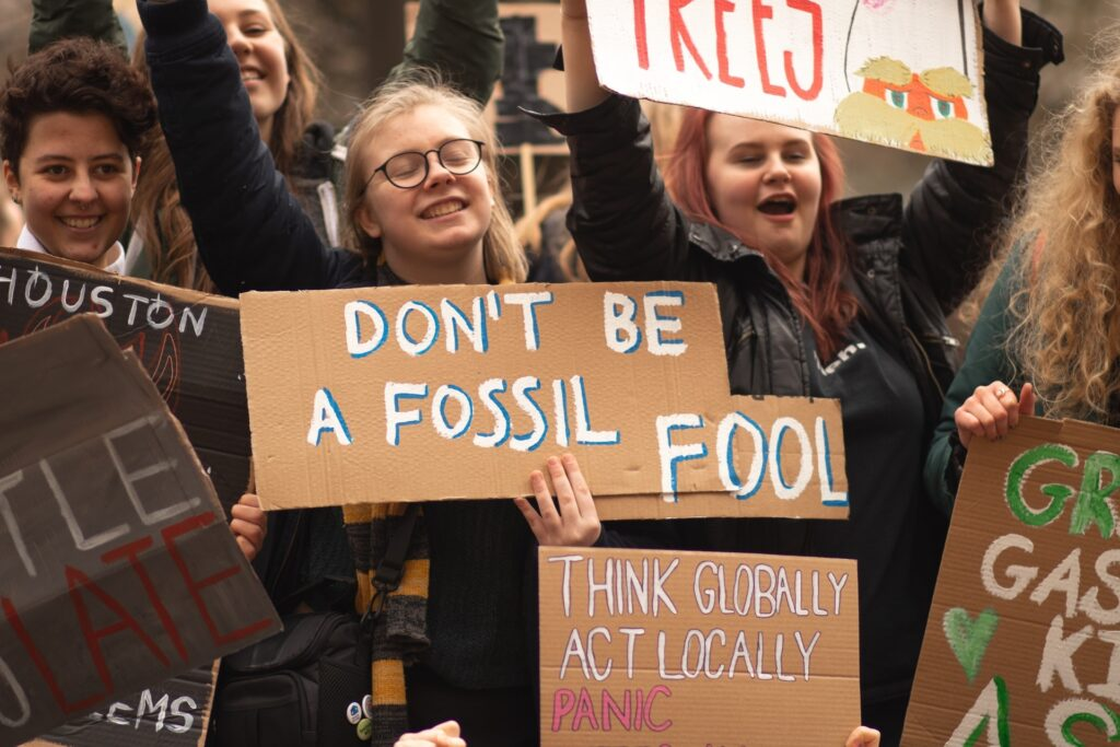 """Image description. Fridays for Future protestors holding a sign: """"Don't be fossil fool"""""""